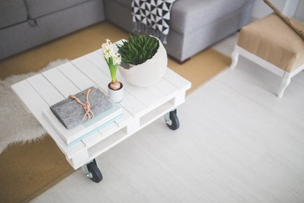 White table in living room with small succulents